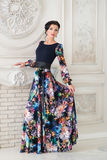 Woman in elegant colorful long dress in studio. Luxury Royalty Free Stock Images