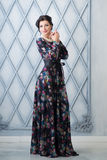 Woman in elegant colorful long dress in studio. Luxury Royalty Free Stock Photo