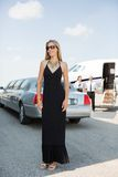 Woman In Elegant Dress At Airport Terminal Stock Photography