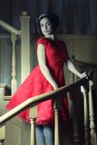 Woman in elegant dress posing on stairs Stock Photography