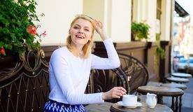 Woman elegant happy face have coffee cafe terrace outdoors. Mug of good coffee in morning gives me energy charge. Girl stock photos