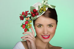 Woman in elegant hat with berry decoration Royalty Free Stock Photo