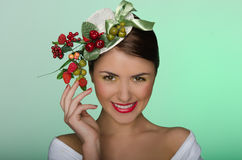Woman in elegant hat with strawberries Stock Photos