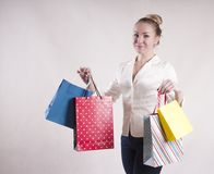 Woman adult   lifestyle shocked  fashionable  a jacket in   housewife packages for purchases studio. Woman elegant   a jacket in    packages for purchases studio Stock Image
