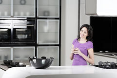 Woman in elegant kitchen Royalty Free Stock Images