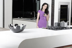 Woman in elegant kitchen Royalty Free Stock Image