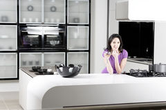 Woman in elegant kitchen Royalty Free Stock Photo