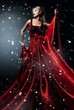Woman in elegant red dress. Professional mak royalty free stock images