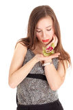 Woman in elegant, silver dress with orchid Stock Photography