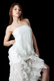 Woman in an elegant white evening gown. Isolated on black Royalty Free Stock Photo