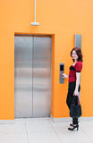 Woman with elevator Stock Images