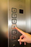Woman in elevator or lift royalty free stock image