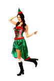 Woman in elf clothes pointing to the right Stock Photography