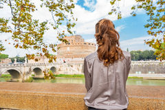 Woman on embankment looking on castel in Rome Royalty Free Stock Images