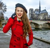 Woman on embankment in Paris, France talking on cell phone Royalty Free Stock Photos