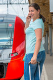 Woman embarks on a journey by train Stock Images