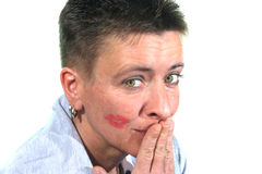 A Woman embarrassed after a kiss Stock Image