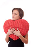 Woman embrace a heart-shape pillow Royalty Free Stock Photos