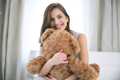 Woman embraced teddy bear Royalty Free Stock Photo