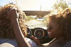 Woman embraces her partner as he drives, close up, Ibiza Stock Images