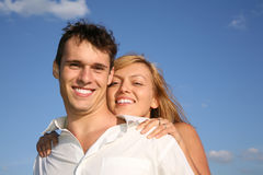 Woman embraces man stock image