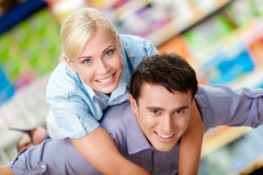 Woman embraces man in the shop Stock Photos