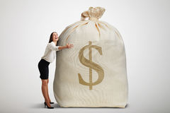 Woman embracing big bag Royalty Free Stock Image