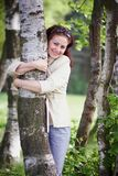Woman embracing a birch Royalty Free Stock Images