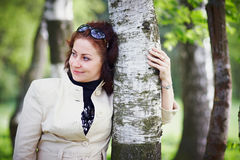 Woman embracing a birch Stock Image