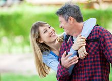 Woman Embracing Boyfriend In Park Royalty Free Stock Images
