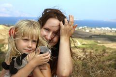 Woman embracing a child on sea background Stock Images