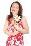 Woman embracing daisy Royalty Free Stock Images