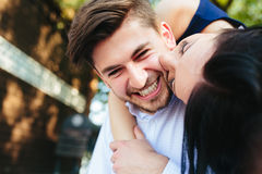 Woman Embracing Her Boyfriend From Behind. Portrait Of Young Woman Embracing Her Boyfriend From Behind Stock Images