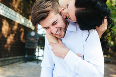 Woman Embracing Her Boyfriend From Behind Stock Images
