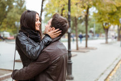 Woman embracing with her boyfriend outdoors Royalty Free Stock Photos