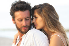 Woman embracing her man from behind on seaside background Stock Photography