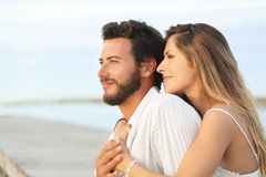 Woman embracing her man from behind on seaside background Stock Photo