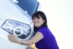 Woman embracing her new car Stock Images