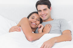 Woman embracing her partner in bed Royalty Free Stock Photos