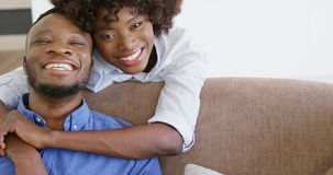 Woman embracing man in living room stock video footage