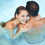 Woman embracing man in water Stock Photo