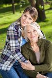 Woman Embracing Mother At Campsite Stock Images