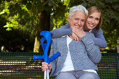 Woman embracing senior Stock Images