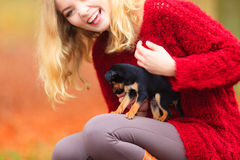 Woman embrancing her puppy dog Royalty Free Stock Photography