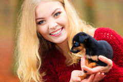 Woman embrancing her puppy dog Royalty Free Stock Image