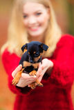 Woman embrancing her puppy dog Stock Images