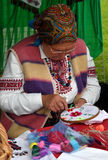 Woman embroiders Stock Photo