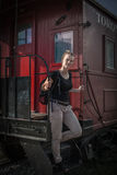 The woman emerges from the historical train Royalty Free Stock Image