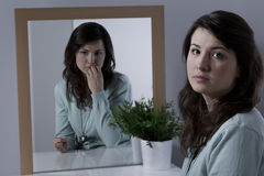 Woman with emotional problem. Worried and scared young woman with emotional problem Stock Photo