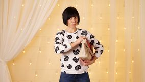 Woman emotionally choose the bag and thinking stock footage